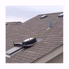 a skylight with a tire, bungee cord and tin to prevent water leaks