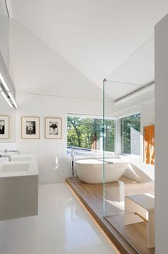 Contemporary Bathroom by Fougeron Architecture FAIA. Bath and shower are on a raised wooden platform.