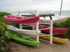 SUP / Kayak Rack by Atlantic Beach Clubs Four, Inc. Seduction Floats™ Floating Resort Cabanas Accessories and storage racks for kayaks and SUP Boards.