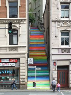 """In the town of Wuppertal, Germany, artist Horst Glasker painted the Holsteiner Stairs in a rainbow of colours calling it """"Scala"""". On each of the 112 stairs are stencils of German words that relate to human relationships, such as love, trust, hope, and dance."""