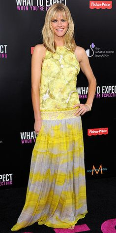 BROOKLYN DECKER  She's a print-mixing master! The actress struts her stuff in a striped and floral yellow Giambattista Valli gown plus Blue Nile gems at the What to Expect L.A. premiere.