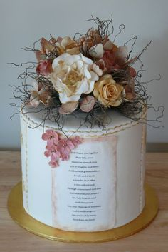 "Double barrel 9"" chocolate mud cake set up with ganache and covered with Fondx RTR. Featuring full bouquet of vintage gumpaste flowers. Use of edible image."