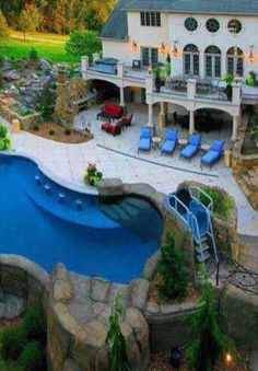 Outdoor living space with walkout basement addition for Basement swimming pool ideas