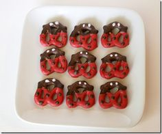 ladybug chocolate pretzels.  I made these for my daughter's first birthday and they turned out really cute!  I found red chocolate disks at Hobby Lobby.  They were easy but a bit time consuming.  I omitted the eyes and they still turned out cute.