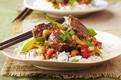 Chunks of beef get meltingly tender in the slow cooker, simmered in an Asian-inspired blend of toasted sesame dressing, garlic and teriyaki sauce.