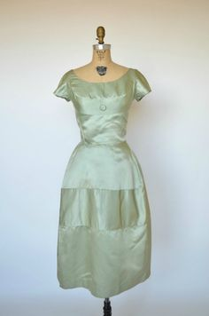 Love the cut of this pale green vintage dress.
