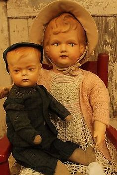 100 year old composition and straw stuffed restored boy baby doll.