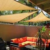 Cover your outdoor space with shade sails outdoor spaces for Garden outlay ideas