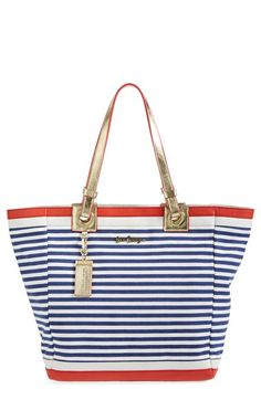 Free shipping and returns on Lilly Pulitzer® 'Cabana' Tote at Nordstrom.com. Perfect for the sophisticated jet-setter, this smartly striped tote features gleaming, metallic leather trim and a water-resistant finish for a polished and practical accessory. The beach-ready design does it all with a spacious interior that easily fits swim and travel essentials or stashes vacation shopping finds.