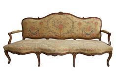 19th-C. French Canapé in the style of Louis XV. The walnut frame is hand-carved and upholstered in petit point tapestry.