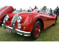 Red Jaguar XK140 on Red Wires
