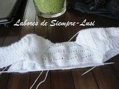 Labores de siempre: Jersey bebé y patucos en blanco