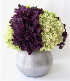 A  row of Silk Flower Arrangement consisting of green and deep purple in a long table will give a simple yet bold look!