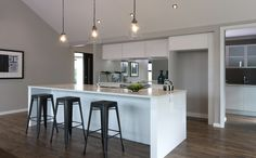The kitchen in our Hamilton showhome, featuring a mirrored splash back and scullery along the back. House Design, Kitchen Flooring, Home, Kitchen Floor Plans, House Inspiration, House Interior, Kitchen Benches, Home Kitchens, Living Design