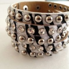 "Zebra print bracelet with silver and rhinestone studs.  Approximately 2"" wide"