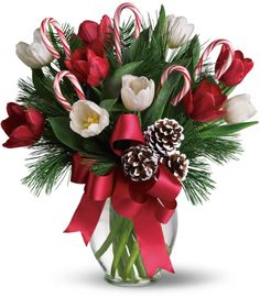 Nothing's sweeter than Christmas tulips - except maybe Christmas tulips with candy canes! This jolly arrangement is about as fun and festive as they come, mixing fresh red and white tulips with fragrant Douglas fir and white pine. Say Merry Christmas to a teacher, friend or loved one far away.