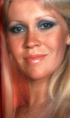 Agnetha from ABBA - showing off her blue eye shadow and a popular disco make up look.