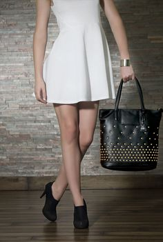 A perfect studded classy shopper bag for ladies. The bag is made up of soft touch leather.