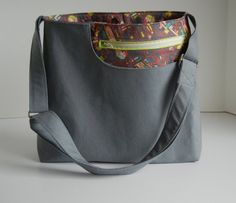 Cross Body Bag:  I like the outside slip pocket (no zipper), but would add a zippered top