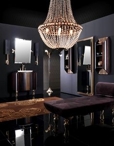 Elegant bathroom furniture with curved lines, composed of washbasin cabinets (wall and floor standing version) and complementary items such as tall units, floor standing cabinets.  Thoughtful integrated storage solutions.