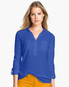 Color blocking into fall. Blue top with yellow pants