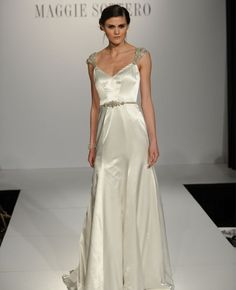 this is so extremely classic & feminine, though you may not like the fitted-ness of it, it could be fit to be a little more draped & less snug up top. I love the silhouette, shoulder detail & the delicate-ness of the belt.