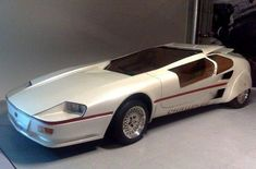 The 1985 Sbarro Challenge 1, a ultra aerodynamic super car of the future powered by a mid mounted, Twin Turbocharged Mercedes Benz V8, hooked up to a 2 speed automatic transmission with a top speed of 300 km/h. - RetroFuturism