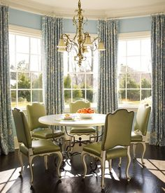 drapes suspended  from continuous rod for the bay window in the dining room