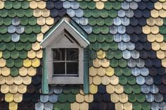 Detailed view of colorful roof shingles and window  Stock Photo