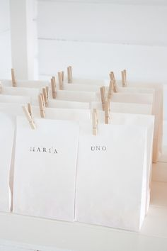Clean and simple. Stamp the name on the bag, fold the top down and pin shut with a mini clothes pin.
