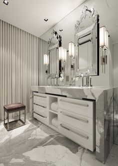 Gray and white strikes a majestic note in the master bathroom. A modern double vanity keeps a low profile while incorporating a mix of storage.