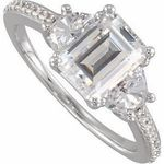 This Regal Engagement Ring Mounting Has a Diamond Accented Band, an Emerald Shape Centerstone Flanked By Half-Moon Shaped Side stones. Customize With Your Favorite Colored Gemstone. Add Half-Moon Cut Diamond Side stones to This Fabulous Mounting That Total 1.5 carats. Choose To Accent This Mounting With 18 Round Cut Diamond Accents Sized 1.10 mm, With a total of 0.09 carats.NOTEThe beautiful luster and shine of a high polish finish in jewelry mountings may create optical illusion white or…