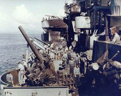 Crew of cruiser USS Nashville inspecting the damage caused by a special attack aircraft (kamikaze) on 13 December 1944 off Mindoro in the Philippines. (US National Archives)
