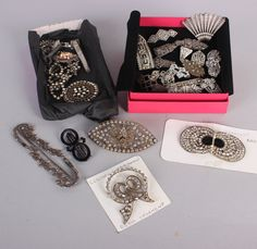 A 1930s silver and marcasite combination dress clip/brooch, a large paste brooch with central raised metal spider on a filigree circle, an early 20th century Czechoslovakian dress ornament, cloak clips, button hole holders and similar jewellery.