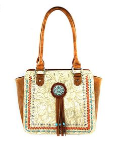Loving this Beige Concho Tassel-Accent Tote on #zulily! #zulilyfinds
