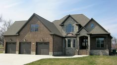 These Chocolate Brown Garage Doors Bring Some Interest To Your Home Our Garage Door Photo