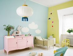 so bright & airy - love the pink cabinet. pink blue yellow. clouds on the walls.