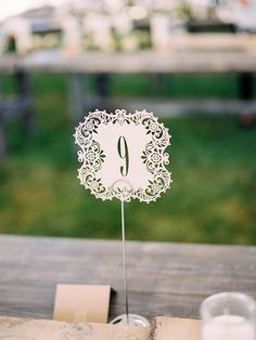 Modern white summer cut-out table number ideas -  white lace shape cut-out table numbers {Pam Cooley Photography}
