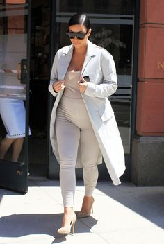 Continuing her trend of monochrome neutral looks, Kim steps out in Beverly Hills wearing an all-over beige ensemble.   - HarpersBAZAAR.com