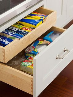 Divided Drawers~ Make the most of a deep drawer with a sliding insert that divides the space. Use it to keep supplies like sandwich bags.