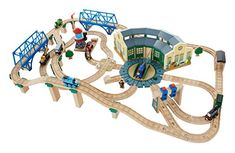 Pieces of the Thomas or Brio train set for Calvins birthday: Fisher-Price Thomas the Train Wooden Railway Tidmouth Sheds Deluxe Set