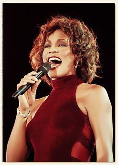 Whitney Houston ... a Grammy gospel tribute .. while wearing a Marc Bouwer ruby velvet gown with sheer sides