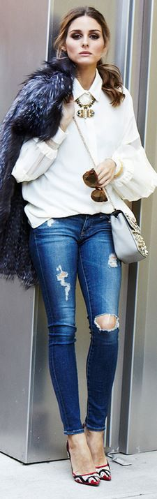 olivia palermo  Who made  Olivia Palermos white long sleeve top, gold jewelry, red print pumps, blue skinny jeans, and gray crystal handbag?...