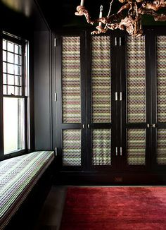 Wardrobe doors are made of criss-crossed metal wires and backed with fabric.  So unique.