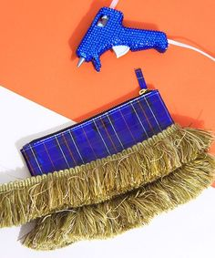 How To Make This Tasseled Clutch In 3 Way Easy Steps  #refinery29  http://www.refinery29.com/fringe-tassel-bag-diy