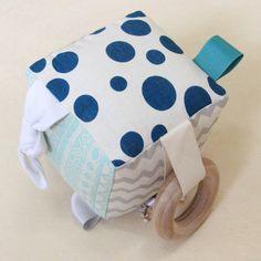 Interactive baby soft block, handmade in Byron Bay by Babee and Me. Teal, aqua, silver geometric, polkadot.