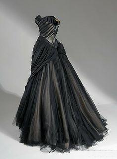 Charles James, Ball gown, 1954-1955. Black silk chiffon, silk satin, netting, and boning.