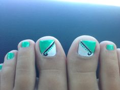 Mint green and white with black and silver line toe nail design.