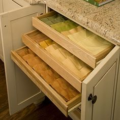 Linen Storage ~ Several shallow drawers are ideal for storing linens. Add them to a cabinet that is near your dining space for extra convenience.