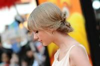 Taylor Swift    Working with a client with some full fringe? The looks Taylor has been debuting on the red carpet with her recently filled out fringe are great for finding inspiration for your bangin' client. Check out this softly pulled back, romantic updo, which is actually placed low and has some fun, twisted details.